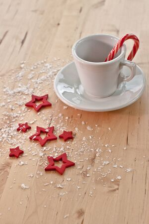 White cup with a candy cane and various red stars photo