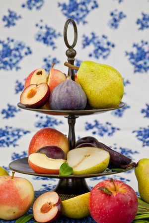 Fresh autumn fruits in a vintage bowl photo