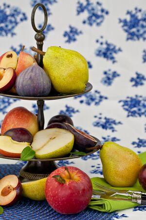 Fresh autumn fruits in a vintage bowl photo