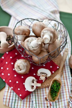 Fresh mushrooms in a heart-shaped mesh basket