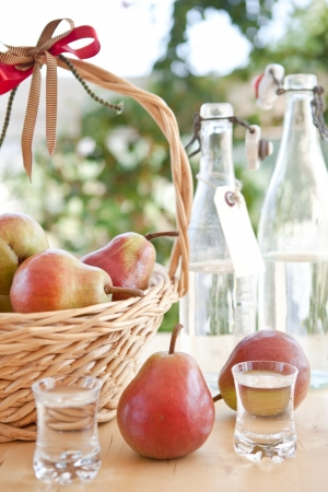 Fresh ripe pears and pear schnapps photo