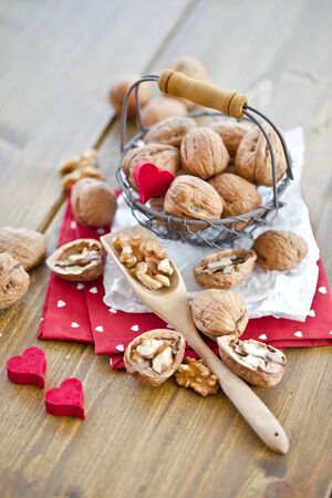 A vintage mesh basket filled with walnuts photo