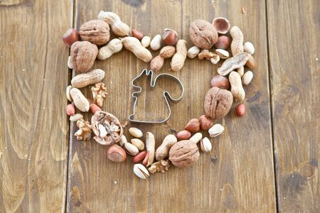 Various nuts arranged in a heart shape photo