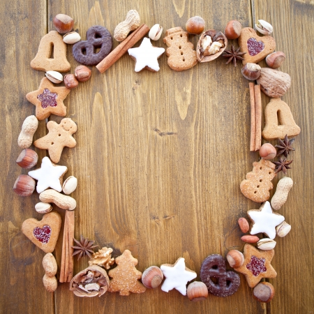 Square-shaped frame made of cookies and nuts for christmas photo
