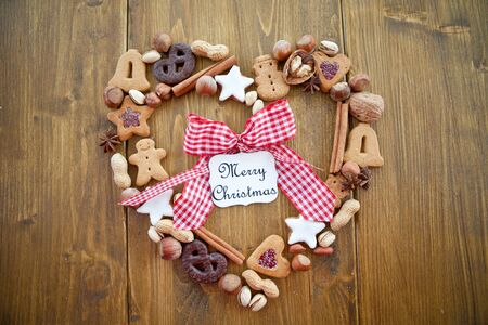 Heart-shaped frame made of cookies and nuts for christmas
