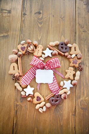 bell shaped: Heart-shaped frame made of cookies and nuts for christmas