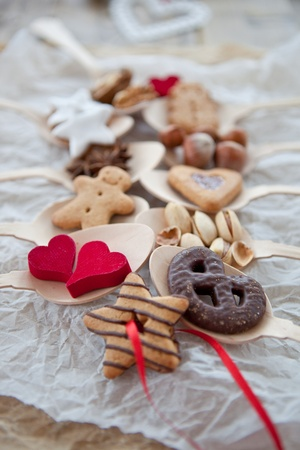 Cookies and nuts for christmas on wooden spoons photo