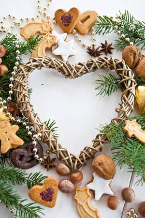 Heart-shaped frame with christmas decoration photo