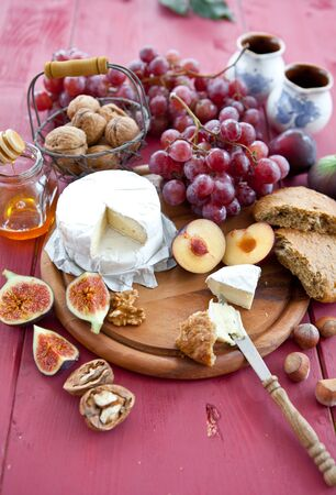Cheese, bread and autumn fruit Stock Photo