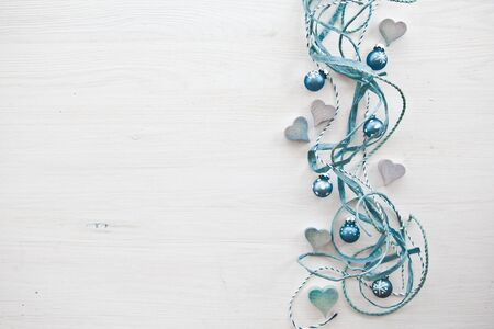 Decorative background with wooden hearts and christmas ornaments