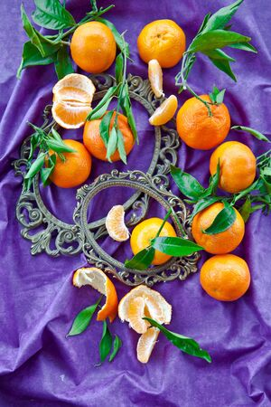 clementines: Fresh clementines on purple