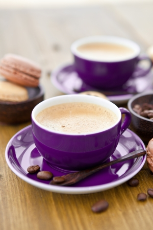 confiserie: Hot espresso and french macaroons Stock Photo