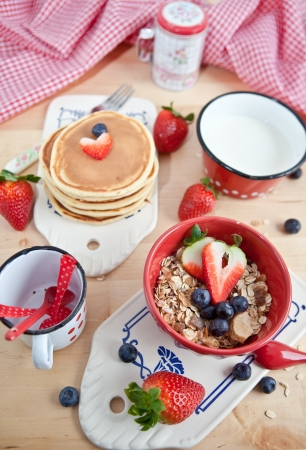 Muesli and pancakes for breakfast photo