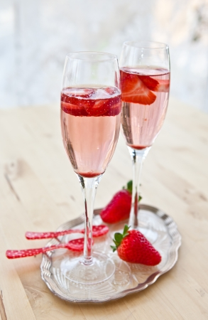 Two glasses of champagne with strawberries