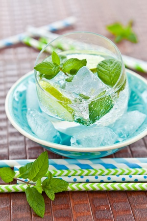 Cold drink with lime and ice Stock Photo - 19291068