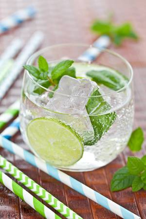 Cold drink with lime and ice photo