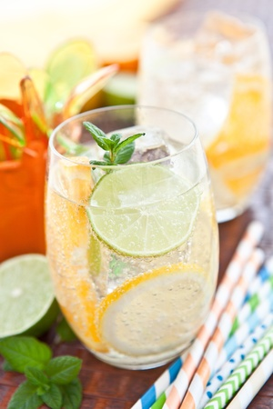 Cold drink with lemons and oranges photo