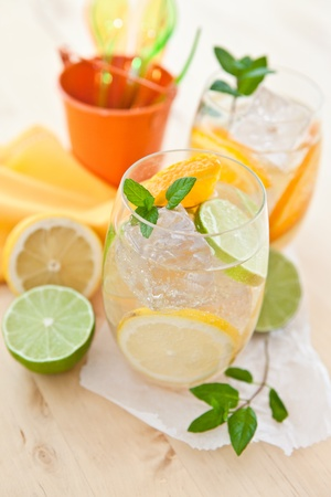 Cold drink with lemons and oranges Stock Photo - 19291053