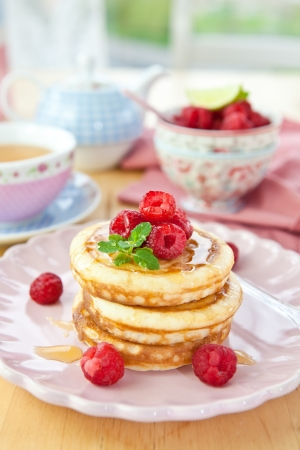 Pancakes with fresh red berries photo