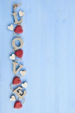 Blue wooden background with LOVE