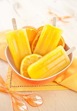 Homemade orange ice popsicles