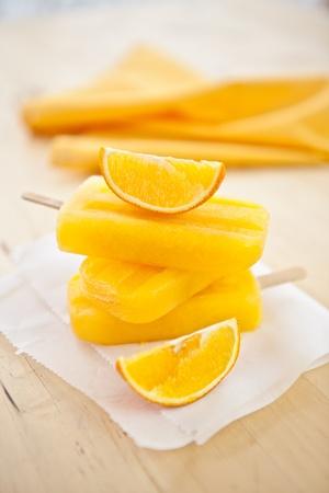 popsicles: Homemade orange ice popsicles