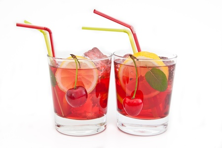 Homemade  lemonade   iced tea with fresh cherries, lemons and mint on white photo