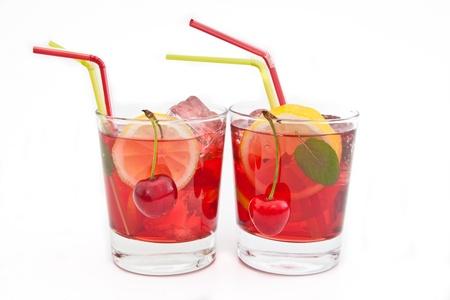 Homemade  lemonade   iced tea with fresh cherries, lemons and mint on white Stock Photo - 20362324