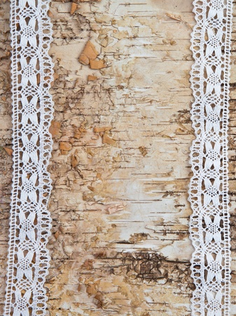 Wooden birch background with white lace border photo