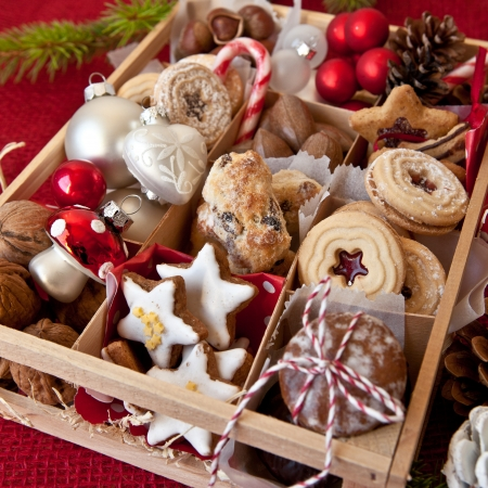 baked treat: Little wooden box with a variety of cookies and nuts for christmas Stock Photo