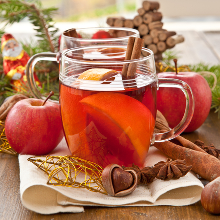 Hot beverage with winter spices for christmas photo