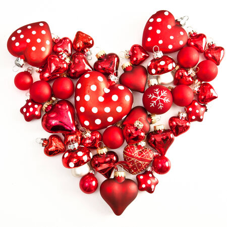 red christmas ornaments in heart shape on white stock photo 24159103 - Red Christmas Ornaments