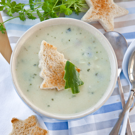 Creamy vegetable soup with fresh cucumber and toasted bread photo