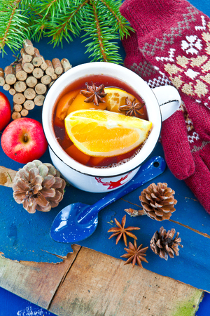 emaille: Hot punch with fresh oranges for christmas Stock Photo