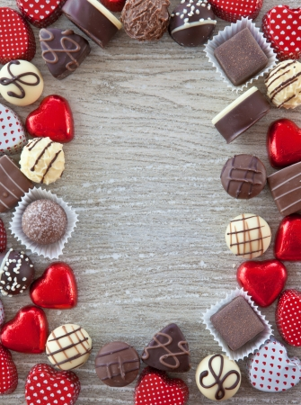 A variety chocolates and truffles on a grey background Stock Photo