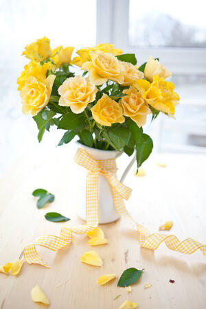 Fresh yellow roses in a vintage emaille can