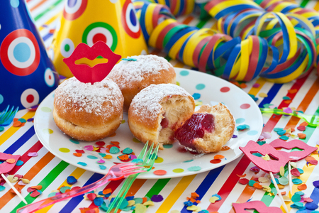 Fresh beignets on colorful plate on a striped background Stock Photo