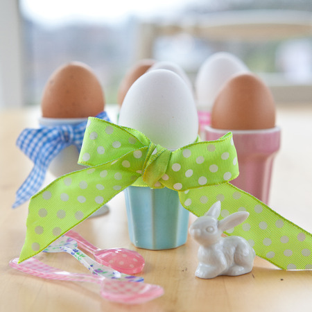 Boiled eggs in colorful cups for easter photo