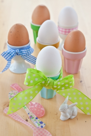 Boiled eggs in colorful cups for easter Stock Photo