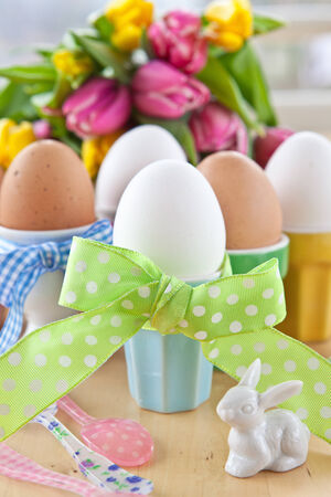 Boiled eggs in colorful cups for easter Stock Photo - 25276019