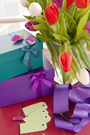 Colorful gift boxes and fresh tulips for easter photo