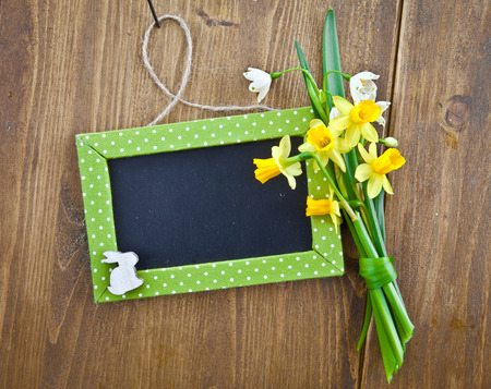 Little chalkboard and spring flowers for easter photo