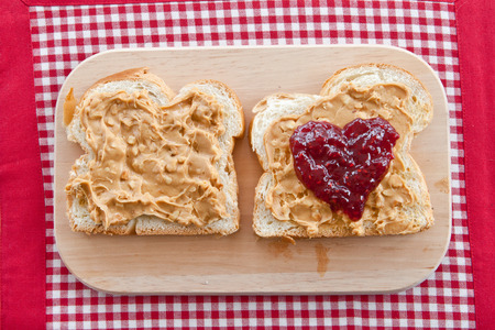 Slices of brioche with peanutbutter and jelly photo