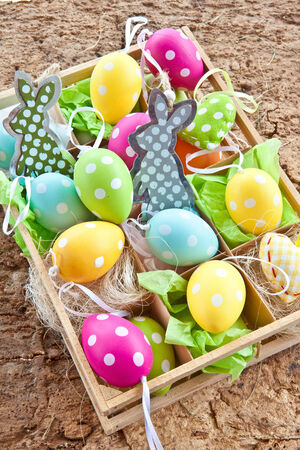 Little box full of colorful easter decoration photo