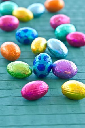 Colorful easter eggs on rustic wooden background photo