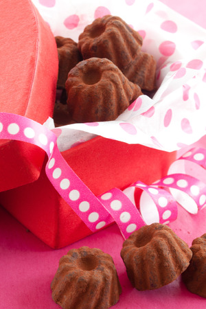 confiserie: Little chocolates in red box in a heart-shape