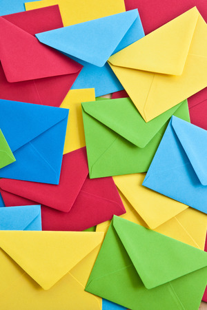 Multi colored envelopes and letters as a background