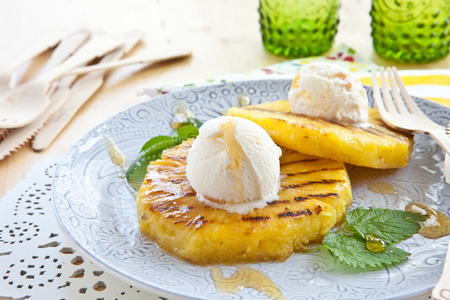 Grilled pineapple with scoops of vanilla ice cream Stock Photo