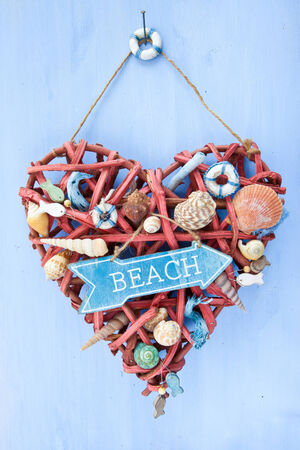 Decorative signpost to the beach on blue wooden  photo