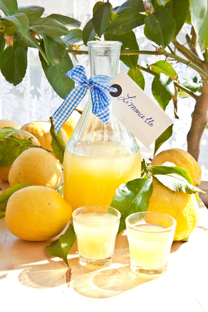 Homemade limoncello made from ripe organic lemons photo